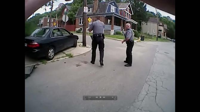 Body cam video shows University of Cincinnati police officers Ray Tensing and Phillip Kidd approaching Dubose vehicle in Cincinnati