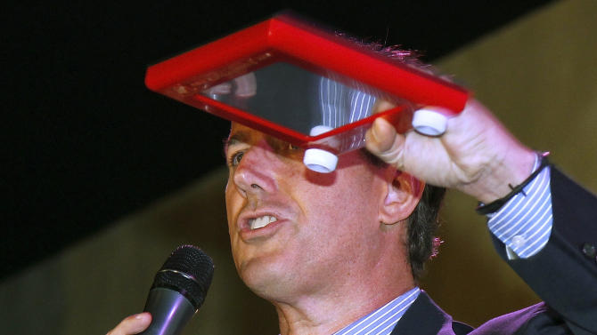 Republican presidential candidate, former Pennsylvania Sen. Rick Santorum holds an Etch A Sketch during a rally in Mandeville, La., Wednesday, March 21, 2012. (AP Photo/Bill Haber)