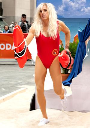Today Show Halloween Costumes 2013: Matt Lauer as Pamela Anderson, Wears Red Swimsuit