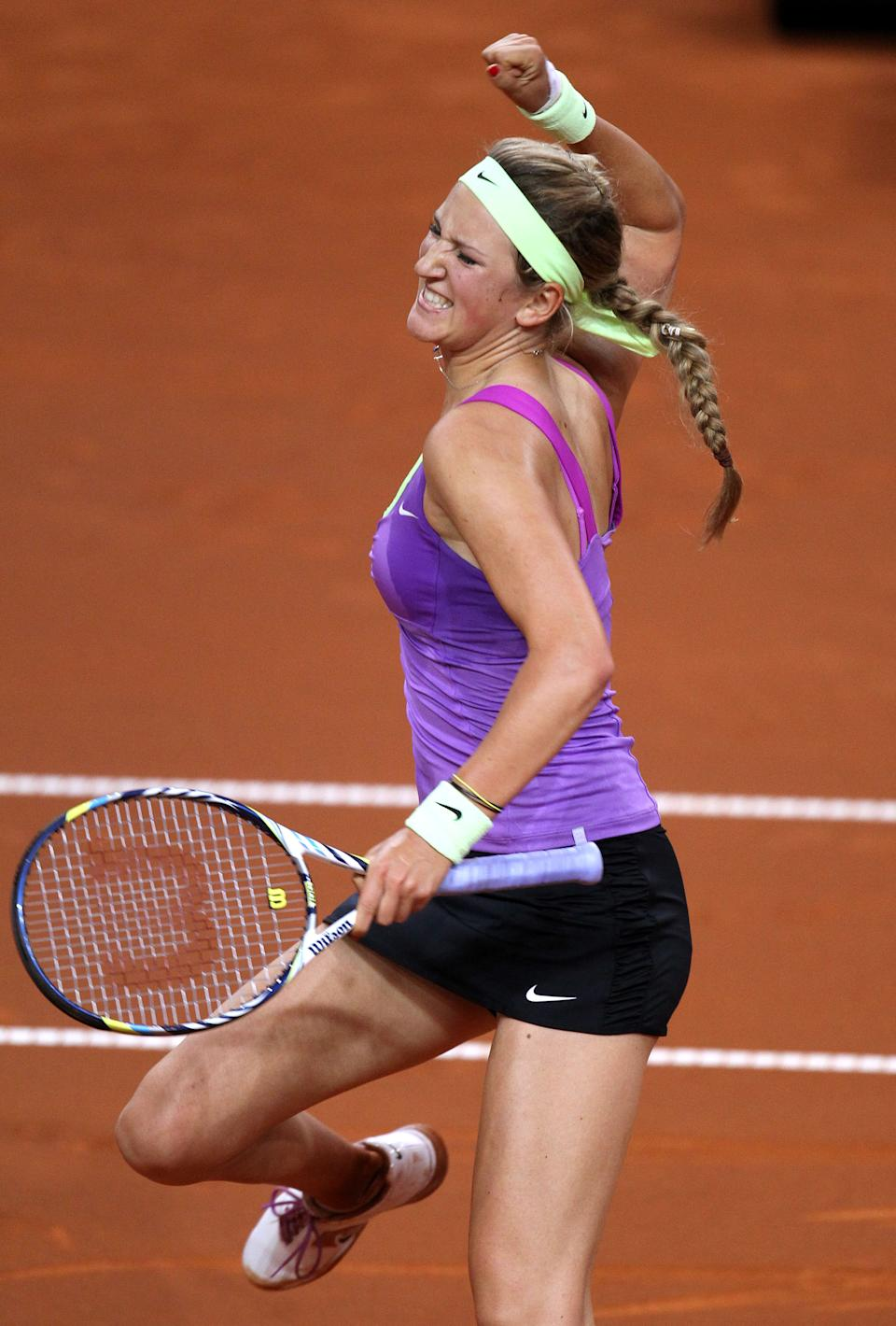 Belarus' Victoria Azarenka celebrates after beating Poland's Agnieszka Radwanska during their semifinal match at the Porsche Tennis Grand Prix in Stuttgart, Germany, Saturday, April 28, 2012. Azarenka won 6-1 and 6-3 to reach Sunday's final. (AP Photo/Michael Probst)