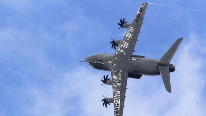 An Airbus A400M military aircraft participates in a flying display during the 50th Paris Air Show