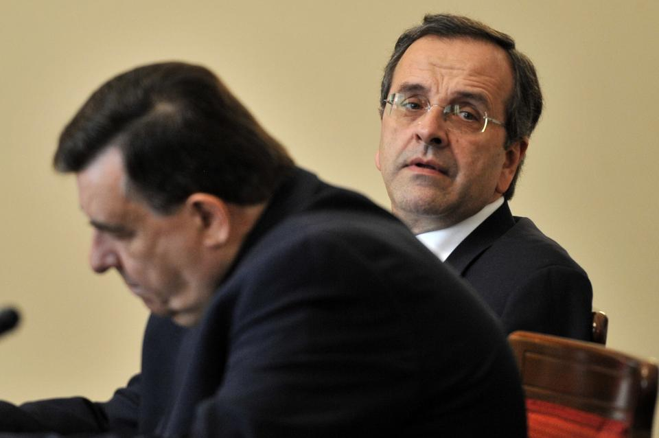 Greece's conservative leader Antonis Samaras, right and right-wing LAOS party leader Giorgos Karatzaferis attend a meeting in Athens on Friday May 27, 2011.Greek political leaders held crisis meeting to find consensus on austerity measures. (AP Photo/Aris Messinis,pool)