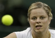 Kim Clijsters of Belgium returns a shot during a second round women&#39;s singles match against Andrea Hlavackova of Czech Republic  at the All England Lawn Tennis Championships at Wimbledon, England, Wednesday, June 27, 2012. (AP Photo/Kirsty Wigglesworth)