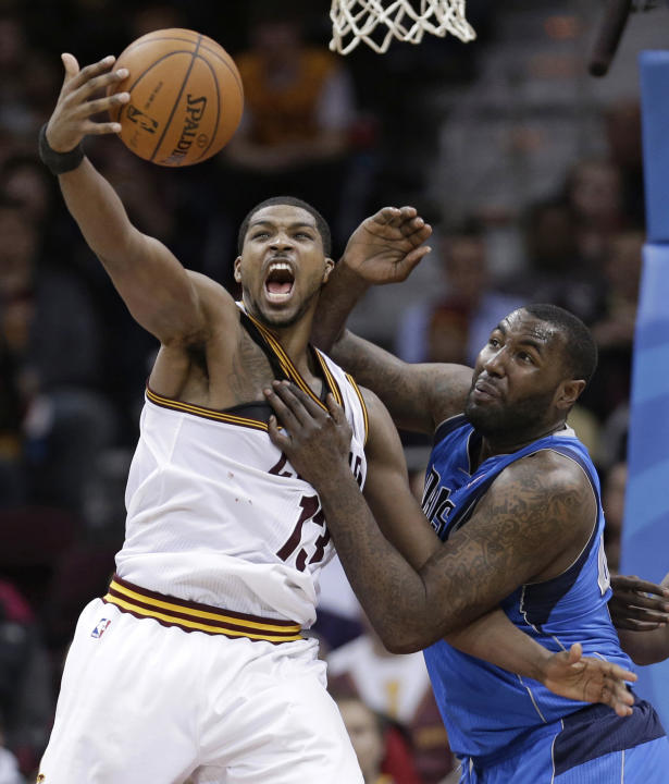 Cleveland Cavaliers' Tristan Thompson, left, from Canada, and Dallas Mavericks' DeJuan Blair battle for a loose ball during the fourth quarter of an NBA basketball game Monday, Jan. 20, 2014,