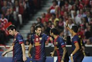 Barcelona's players celebrate scoring a goal against Benfica during their Champions League match against Benfica, in Lisbon, on October 2. Real Madrid face Barcelona in a make-or-break El Clasico on Sunday aided by a resurgent Cristiano Ronaldo but acutely aware that defeat would see them trail their bitter enemies by a massive 11 points