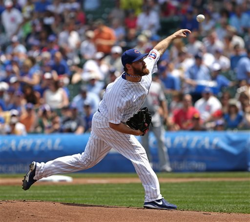 Chicago Cubs starting pitcher Travis Wood throws to the New York Mets in the first inning in a baseball game in Chicago, Sunday, May 19, 2013