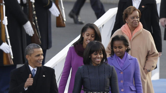 President Barack Obama, first lady Michelle Obama and Malia and Sasha Obama and Michelle Obama's mother Marian Robinson walk down to the Presidential reviewing stand in front of the White House, Monday, Jan. 21, 2013, in Washington. Thousands  marched during the 57th Presidential Inauguration parade after the ceremonial swearing-in of President Barack Obama. (AP Photo/Charlie Neibergall )