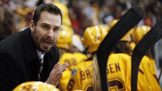 Minnesota head coach Brad Frost talks to his team on the bench during the game against Boston University in the women's Frozen Four NCAA Championship college hockey game, Sunday, March 24, 2013, in Minneapolis. (AP Photo/Stacy Bengs)