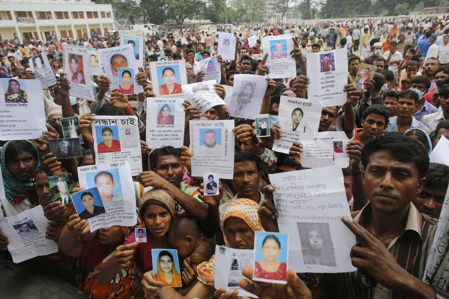 http://news.yahoo.com/lightbox/deadly-building-collapse-in-bangladesh-1366797674-slideshow/relatives-mourn-show-pictures-garment-workers-believed-trapped-photo-093538525.html