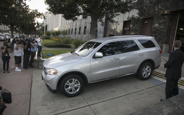 U.S. Federal marshals drive away in a vehicle believed to be carrying Nakoula Basseley Nakoula after his arraignment in federal court in Los Angeles Thursday, Sept. 27, 2012. A federal judge on Thursday ordered Nakoula, the man behind a crudely produced anti-Islamic video that inflamed parts of the Middle East to be detained because he is a flight risk and for violating terms of hisprobation. (AP Photo/Damian Dovarganes)