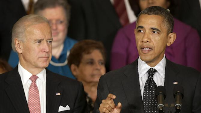 President Barack Obama, accompanied by Vice President Joe Biden, gestures as he speaks about the economy and the deficit, Friday, Nov. 9, 2012, in the East Room of the White House in Washington. (AP Photo/Pablo Martinez Monsivais)