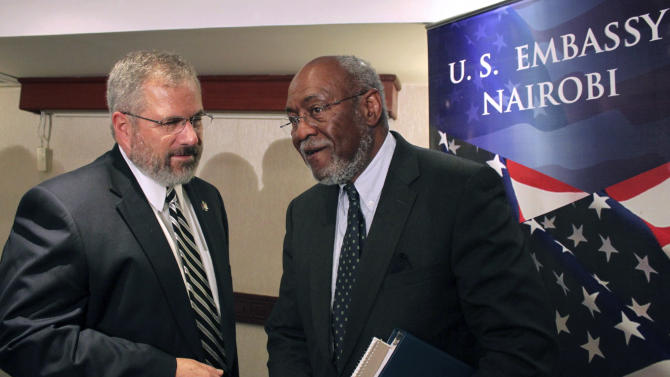 Assistant Secretary of State for African Affairs Johnnie Carson, center, speaks with U.S. Ambassador to Kenya Scott Gration, left, at a hotel in Nairobi, Kenya Sunday, June 10, 2012 shortly after Carson returned from a trip to Mogadishu, Somalia. The highest ranking U.S. official to visit Somalia's capital in years landed in Mogadishu on Sunday in another sign of improving security in the Horn of Africa's most chaotic nation. (AP Photo/Jason Straziuso)