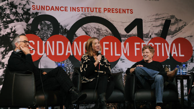 Sundance Film Festival Director John Cooper, left, Sundance Institute Executive Director Keri Putnam, center, and Robert Redford, founder and president of the Sundance Institute, share a laugh during the opening news conference of the 2014 Sundance Film Festival on Thursday, Jan. 16, 2014, in Park City, Utah. The independent film festival runs Jan. 16-26, 2014. (Photo by Chris Pizzello/Invision/AP)