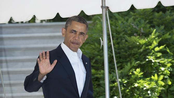 President Barack Obama leaves the White House in Washington for a trip to the tornado devastated town of Moore, Okla., Sunday, May 26, 2013.   (AP Photo/Manuel Balce Ceneta)