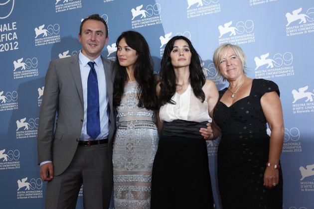 From left, producer Nicolas Gonda, actresses Romina Mondello, Olga Kurylenko and producer Sarah Green pose at the photo call of the film 'To The Wonder' at the 69th edition of the Venice Film Festival in Venice, Italy, Sunday, Sept. 2, 2012. (AP Photo/Joel Ryan)