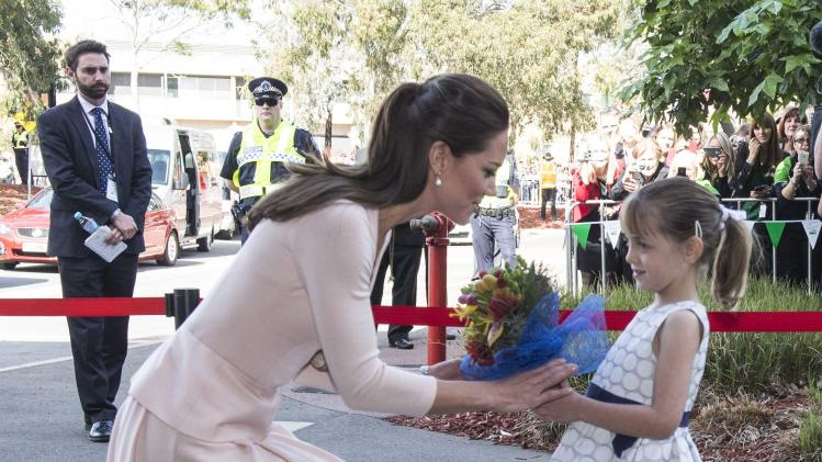Britain's Catherine, Duchess of Cambridge is given a bouquet of flowers by Lauren Stepherson at the youth community centre, The Northern Sound System, in Elizabeth near Adelaide