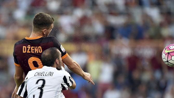 AS Roma's Dzeko heads the ball and score against Juventus during their Serie A soccer match at Olympic stadium in Rome