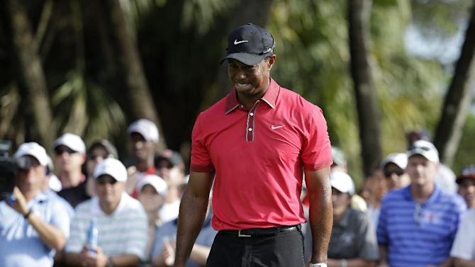 Woods says he's healing slowly from back surgery