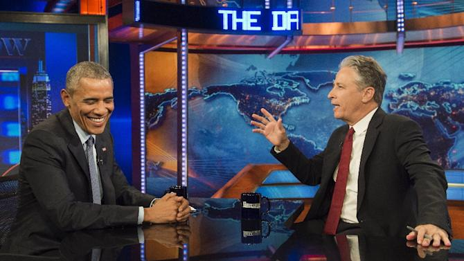 """US President Barack Obama speaks with Jon Stewart, host of """"The Daily Show with Jon Stewart,"""" during a taping of the show in New York, July 21, 2015"""