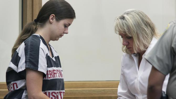 Elizabeth Johnson completes paperwork after being sentenced Friday, Dec. 7, 2012 in Phoenix. Johnson, an Arizona woman who was convicted in her young son's disappearance nearly three years ago was sentenced Friday to 5 1/4 years in prison after tearfully telling the judge she thought she deserved the maximum of 9 1/2 years. (AP Photo/The Arizona Republic, Mark Henle)  MARICOPA COUNTY OUT; MAGS OUT; NO SALES