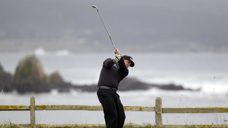 Phil Mickelson hits from the 18th tee at Pebble Beach Golf Links during the final round of the AT&T Pebble Beach National Pro-Am golf tournament in Pebble Beach, Calif., Sunday, Feb. 12, 2012. Mickelson finished with an 8-under 64 to win the Pebble Beach National Pro-Am and become only the ninth player with 40 career PGA Tour wins. (AP Photo/Eric Risberg)
