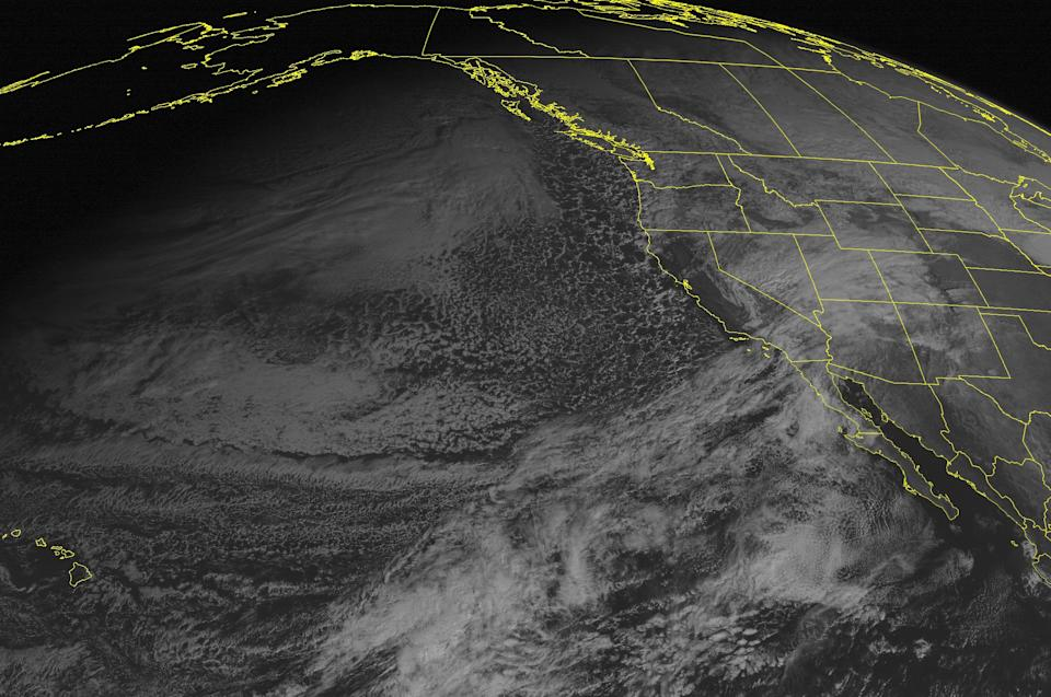 This NOAA satellite image taken Tuesday, December 18, 2012 at 02:00 PM EST shows a few clouds in the Rockies where low pressure continues to develop.  This low will intensify through the week, eventually bringing a strong winter storm to the Northeast. (AP Photo/Weather Underground)