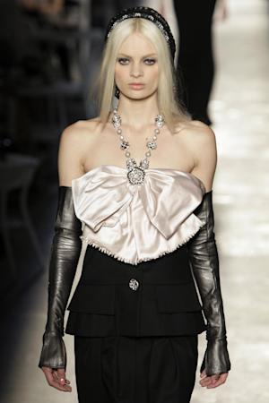 A model wears a creation of Chanel by fashion designer Karl Lagerfeld during his Women's Fall Winter 2013 haute couture fashion collection in Paris, France, Tuesday, July 3, 2012. (AP Photo/Francois Mori)