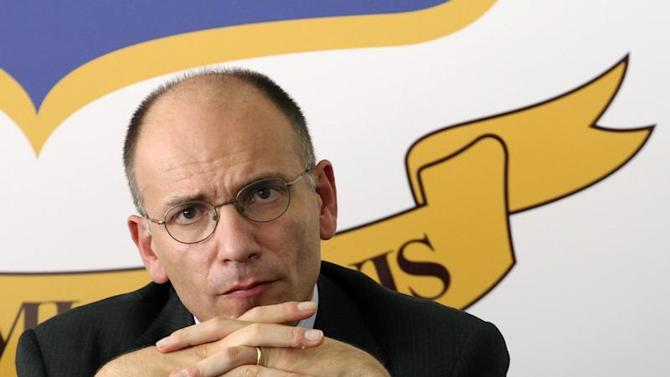 Italy's PM Enrico Letta attends a news conference in Lampedusa