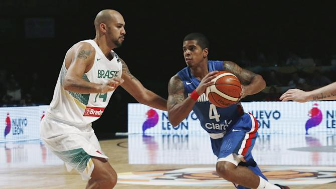 Brazil's Marquinhos defends against Dominican Republic's Sosa during their 2015 FIBA Americas Championship basketball game at the Sport Palace in Mexico City