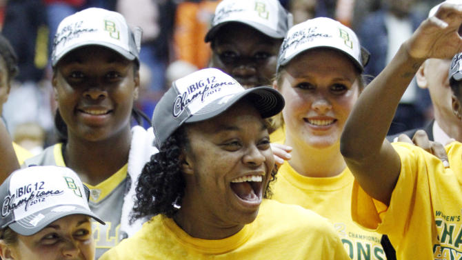 Baylor guard Odyssey Sim (0) celebrates after the victory over Texas A&M in an NCAA college basketball championship game at the women's Big 12 Conference tournament, Saturday, March 10, 2012 in Kansas City, Mo. Baylor won the game 73-50. (AP Photo/Jeff Tuttle)