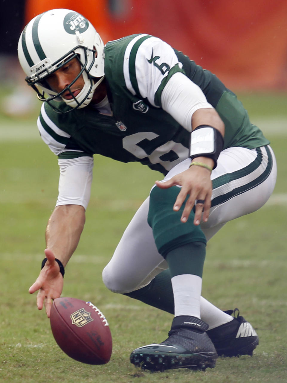 New York Jets quarterback Mark Sanchez fumbles the ball and then recovers it during overtime of an NFL football game against the Miami Dolphins, Sunday, Sept. 23, 2012, in Miami. The Jets won 23-20 in overtime. (AP Photo/Wilfredo Lee)