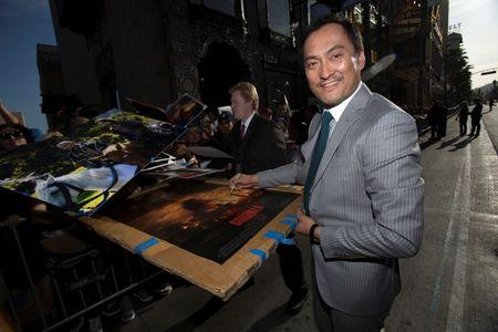"Cast member Watanabe signs autographs at the premiere of ""Godzilla"" at the Dolby theatre in Hollywood"