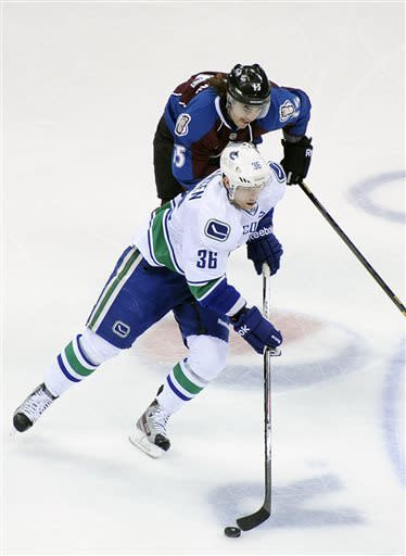Hejda lifts Avs past Canucks, 4-3