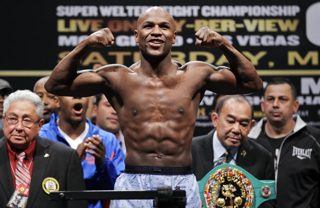 FILE - In this May 4, 2012 file photo, Floyd Mayweather Jr. flexes during his weigh-in for his super welterweight title fight against Miguel Cotto in Las Vegas. Mayweather Jr. finally confirms he'll fight Robert Guerrero on May 4, but the biggest star in boxing says he'll continue his career on a different network. After several years on HBO, Mayweather has signed a multifight deal with Showtime. (AP Photo/Julie Jacobson, File)
