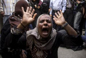 An Egyptian woman screams after a judge sentenced to …