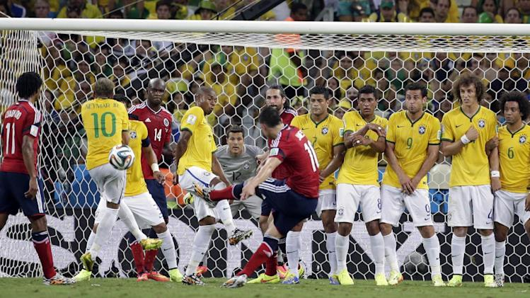 Brazil's Neymar, second right, blocks a free kick  by Colombia's James Rodriguez during the World Cup quarterfinal soccer match between Brazil and Colombia at the Arena Castelao in Fortaleza, Brazil, Friday, July 4, 2014