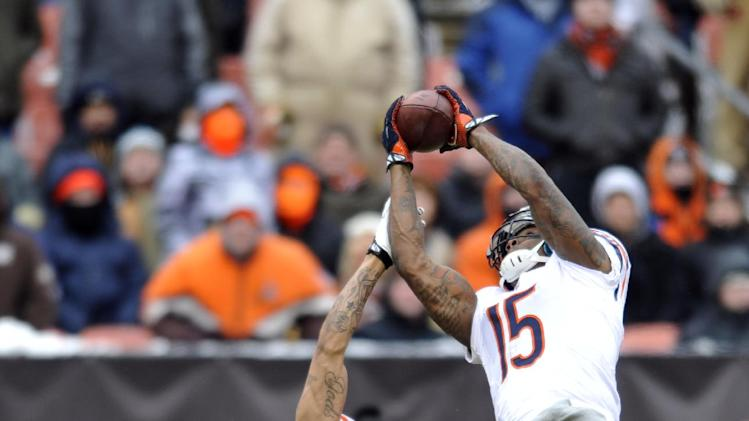 In this Dec. 15, 2013, file photo, Chicago Bears wide receiver Brandon Marshall (15) makes a catch against Cleveland Browns cornerback Joe Haden (23) during an NFL football game in Cleveland. During preseason games this year, NFL officials have been calling more penalties for illegal contact between defenders and receivers
