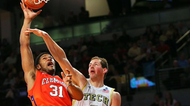 Clemson forward Devin Booker (31) shoots past Georgia Tech center Daniel Miller (5) during the second half of their NCAA college basketball game, Thursday, Feb. 14, 2013, in Atlanta. Clemson won 56-53. (AP Photo/Atlanta Journal-Constitution, Curtis Compton)  MARIETTA DAILY OUT; GWINNETT DAILY POST OUT; LOCAL TV OUT; WXIA-TV OUT; WGCL-TV OUT
