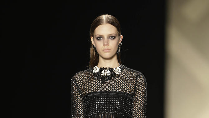 A model wears a creation for Roberto Cavalli women's Fall-Winter 2013-14 collection, part of the Milan Fashion Week, unveiled in Milan, Italy, Saturday, Feb. 23, 2013. (AP Photo/Luca Bruno)