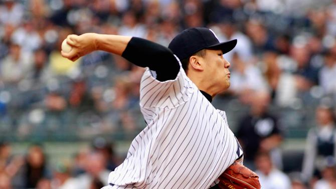 Masahiro Tanaka the New York Yankees pitches against the Toronto Blue Jays at Yankee Stadium on September 21, 2014