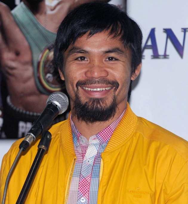 Philippine Boxing Icon And Congressman Manny Pacquiao Smiles AFP/Getty Images