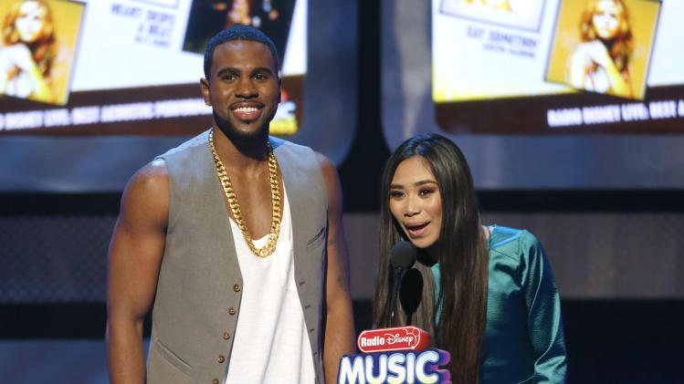 Jason Derulo and Jessica Sanchez onstage during the Radio Disney Music Awards at the Nokia Theatre on Saturday, April 27, 2013 in Los Angeles. (Photo by Todd Williamson /Invision/AP)