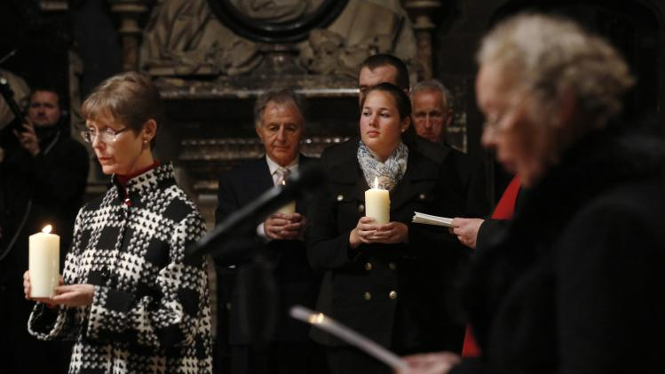 Friends and relatives hold memorial candles during service of remembrance for Lockerbie air disaster in London