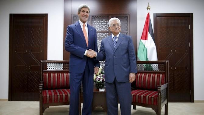FILE - In this July 23, 2014, file photo, U.S. Secretary of State John Kerry meets with Palestinian Authority President Mahmoud Abbas, right, in Ramallah. It's a busy week in Mideast diplomacy, book-ended by the launch of Israel-Hamas talks about a border deal for blockaded Gaza and the Palestinian president's U.N. speech scheduled for Friday, Sept, 26, 2014, about a new strategy for dealing with Israel. (AP Photo/Charles Dharapak, File)