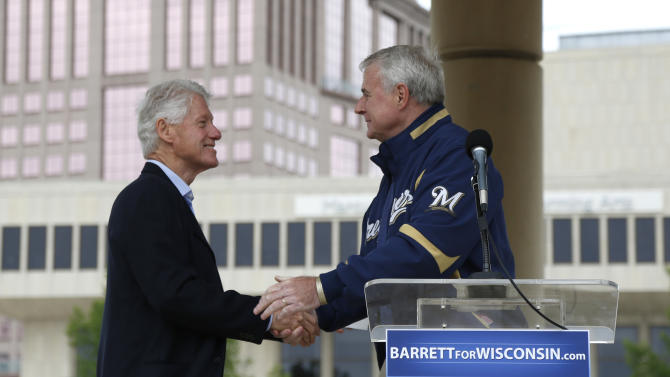 Former President Bill Clinton, left, is welcomed by Democratic candidate for Wisconsin Gov. Tom Barrett at a recall election rally Friday, June 1, 2012, in Milwaukee. Clinton urged hundreds of Wisconsin Democrats to vote out Republican Gov. Scott Walker in next week's recall election because he refused to govern through compromise and honest negotiation.  (AP Photo/Jeffrey Phelps)