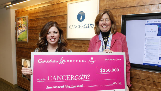 IMAGE DISTRIBUTED FOR CARIBOU COFFEE -  In this image released on Thursday, Nov. 15, 2012, Sarah Townes, left, director of brand development and communications, presents CancerCare® CEO Helen Miller with Caribou Coffee's largest-ever annual Amy's Blend donation of $250,000, supporting the organization's free services for those affected by breast cancer, on Wednesday, Nov. 14, 2012 at CancerCare headquarters in New York.  As part of its 17th annual Amy's Blend program, Caribou announced a new partnership this year with CancerCare, a national nonprofit organization committed to providing free support services for anyone affected by cancer. From Saturday, Sept. 29, 2012 through Wednesday, Nov. 7, 2012, Caribou offered its special Amy's Blend collection of coffee, tea and merchandise in honor of the company's original roastmaster Amy Erickson, who lost her battle with breast cancer in 1995. Caribou was proud to donate 10 percent of all Amy's Blend collection proceeds to CancerCare to support those in Caribou Coffee communities who have been impacted by the disease. Caribou is excited to thank its fans and team members who helped the company to raise its largest amount yet in support of this cause, with the final donation to CancerCare for this year's program reaching $250,000. (Jason Decrow/AP Images for Caribou Coffee)