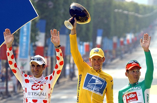 FILE - This July 28, 2002 file photo shows Lance Armstrong, center, waving from the podium as he holds the winner&#39;s trophy, along with best sprinter Robbie McEwen, of Australia, right, and best climber Laurent Jalabert, of France, after the 20th and final stage of the Tour de France cycling race between Melun and Paris. Armstrong was stripped of his seven Tour de France titles and banned for life by cycling&#39;s governing body Monday, Oct. 22, 2012, following a report from the U.S. Anti-Doping Agency that accused him of leading a massive doping program on his teams. UCI President Pat McQuaid announced that the federation accepted the USADA&#39;s report on Armstrong and would not appeal to the Court of Arbitration for Sport. (AP Photo/Peter Dejong)