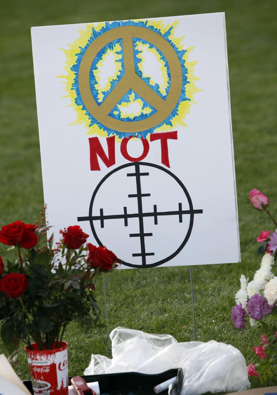 A sign is shown on the lawn of University Hospital Sunday, Jan. 9, 2011 in Tucson, Ariz. for U.S. Rep. Gabrielle Giffords, D-Ariz., and others who were shot a day earlier during a Giffords speech at a local supermarket. (AP Photo/Matt York)