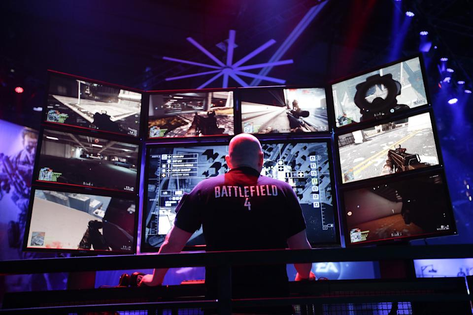 A gamer plays the video game Battlefield 4 at the EA booth during the Electronic Entertainment Expo in Los Angeles, Wednesday, June 12, 2013. (AP Photo/Jae C. Hong)