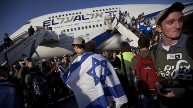 New Jewish immigrants from U.S. arrive at the Ben Gurion airport near Tel Aviv, Israel, Tuesday, Aug. 14, 2012.  A total of 350 immigrants arrived on the flight from the U.S. Tuesday, and were welcomed by Israel's Prime Minister Benjamin Netanyahu in a ceremony at the airport. Over 100 of the new immigrants are expected to join the Israel Defense Forces in the upcoming month. (AP Photo/Oded Balilty)